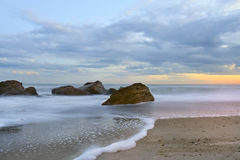 Beach and calm sea at sunset Royalty Free Stock Photography
