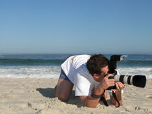 Beach Camera. Man taking a picture with his camera on the beach Royalty Free Stock Images