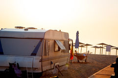 Beach camping. Camping at the beach in a trailer with the orange morning light royalty free stock images