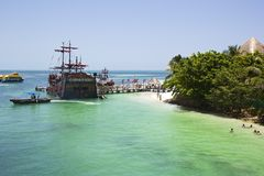 Beach in Cancun. With pirate boat and other boats on the background Stock Image