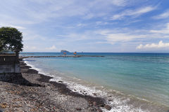 Beach at Candidasa, Bali, Indonesia. Image of a beautiful beach with volcanic black sand at Candidasa, Bali, Indonesia Royalty Free Stock Photo