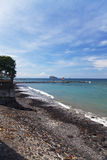 Beach at Candidasa, Bali, Indonesia. Image of a beautiful beach with volcanic black sand at Candidasa, Bali, Indonesia Royalty Free Stock Image
