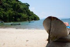 Beach canoe. A canoe on the beach in Paraty, Brazil Royalty Free Stock Photo