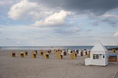 Beach with canopied wicker beach chairs in Travemünde. At the Baltic Sea Royalty Free Stock Photos