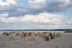 Beach with canopied wicker beach chairs in Travemünde. At the Baltic Sea Royalty Free Stock Image