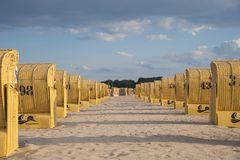 Beach with canopied wicker beach chairs in Travemünde. At the Baltic Sea Stock Photo