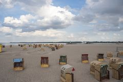Beach with canopied wicker beach chairs in Travemünde. At the Baltic Sea Royalty Free Stock Photography