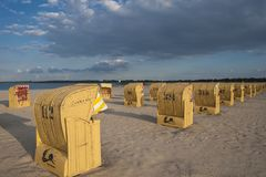 Beach with canopied wicker beach chairs in Travemünde. At the Baltic Sea Royalty Free Stock Images
