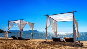 Beach canopies with sun loungers on beach.  royalty free stock photos