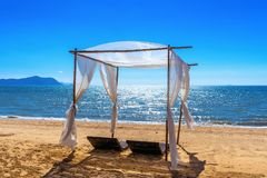Beach canopies with sun loungers on beach.  stock photography