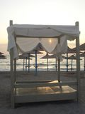 Beach canopy and parasols at sunrise. In Vama Veche, Romania Royalty Free Stock Photography