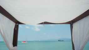 Beach canopy on sea view in sunny day. Gazebo at a resort in slow motion. 1920x1080