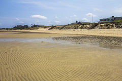 Beach at Cape Cod. Beach with houses in background at Cape Cod in the USA Stock Photo