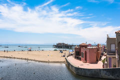 The beach of Capitola, California. View of the sand beach and the pier of Capitola, California Stock Photos