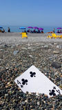Playing card on the beach Royalty Free Stock Images