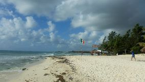 Beach caribbean coast with Mexican Flag Mexiko royalty free stock image
