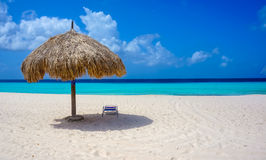 Beach in Caribbean. With parasol and chair and a ocean with two tons of blue stock photos
