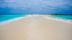 Beach in Caribbean with a sand pathway. Beach in Caribbean with blue water and a sand pathway connecting two islands stock photography