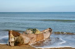 Colombian beach and old wooden dugout canoe Stock Images