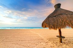 Beach at Caribbean sea in Mexico. Parasol on the beach of Caribbean Sea at sunrise, Mexico Stock Photos