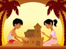 Beach castle. Boy and girl having fun at the beach on vacation holiday Royalty Free Stock Photography