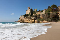 Beach and castle of Tamarit Royalty Free Stock Image