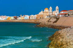 Beach and Cathedral in Cadiz, Andalusia, Spain Stock Photos