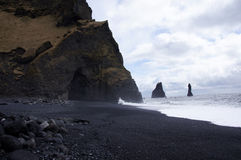 Beach and cave at Reynisdrangar in Vik Stock Image