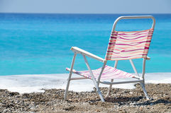 Beach chair. Chair next to beach with blue water Royalty Free Stock Photography