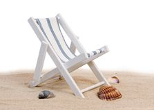 Beach chair. Decorative beach chair and shells on the sand background stock photos