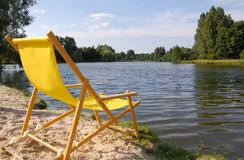 Beach chair. On the lake side royalty free stock photo