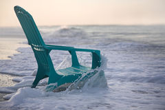 Beach chair. On the shore early morning stock image