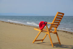 Beach chair. With red hat and sunglasses Stock Photography