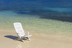 Beach Chair. Chair are waiting you on a white sandy beach facing the turquoise waters of the Maldives royalty free stock photo