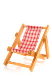 Beach chair. Wooden folding bach chair with checkered textile Royalty Free Stock Photo