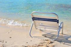 Beach Chair. Relaxing beach chair near the ocean waves Royalty Free Stock Photography