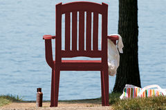 Beach Chair. Red beach chair in front of water Royalty Free Stock Photography