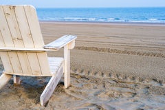 Beach chair. A beach chair on an empty beach in the early morning sun royalty free stock image