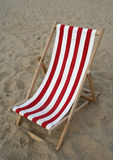 Beach chair. Empty red/white classic wooden beach chair at the beach Royalty Free Stock Photos