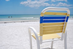 Beach chair. On the sand, in front of the ocean, on a sunny summer day Royalty Free Stock Photography