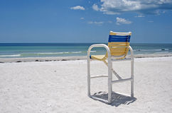 Beach chair. On the sand, in front of the ocean, on a sunny summer day Royalty Free Stock Images