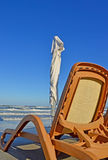 Beach and chair. Beach umbrella and lounge chair Royalty Free Stock Photo