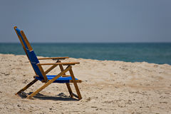 Beach Chair. Empty chair on the beach, the owner nowhere to be found Royalty Free Stock Photography