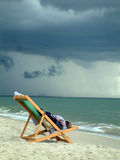 Beach Chair. Comfortable beach chair with a storm brewing on the horizon Royalty Free Stock Image