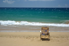 Beach chair. Sitting near the edge of the water Stock Image