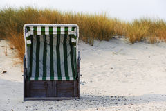 Beach chair in the autumn Stock Images
