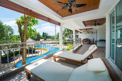 Beach chair at balcony pool view in home Royalty Free Stock Photo