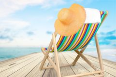 Beach chair. Beach lounger chair white hat object stock images