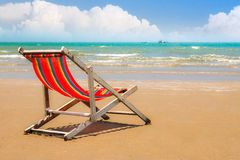 Beach chair on the beach with clear blue sky. Single beach chair on the beach with clear blue sky in summer Stock Photo