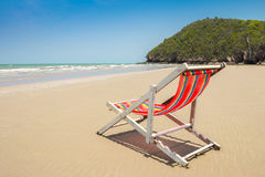 Beach chair on the beach and mountain with clear blue sky scenic Stock Images